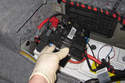 Lift battery power module up and remove from battery.