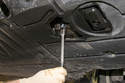 Using a 17mm socket, remove oil drain plug.