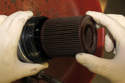 Remove oil filter cover from engine and remove old oil filter from cover.