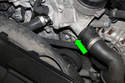 This photo shows part of tensioner you insert your Torx bit into the release tension. (green arrow)