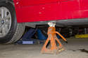 Once you reach desired height, install jack stand at jack pad location to support the vehicle.