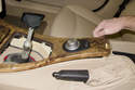 Using a plastic prying tool, gently lever out center console trim piece.