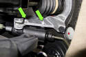 Working at the top of clutch master cylinder (green arrow), remove two 10mm fasteners.