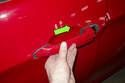 Grab exterior door handle and push toward rear of vehicle.