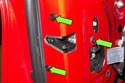 Remove three T30 Torx door latch fasteners.