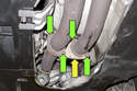 Working at front of exhaust system, remove four 13mm nuts that connect exhaust system to exhaust manifold.