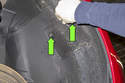 To access turn signal bulb without removing front section of wheel well liner, remove the access door.