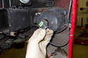 Rotate fog light bulb socket counterclockwise to remove.