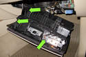 Lower glove compartment, then detach electrical connectors (green arrows).