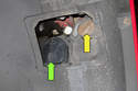 With the access door removed, you can service the low beam headlight bulb (green arrow) or the turn signal bulb (yellow arrow).