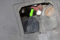 To replace low beam bulb, unlock spring on headlight bulb access door.