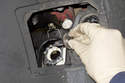 Pull headlight bulb out of headlight and replace.
