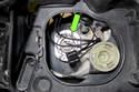 Unclip headlight bulb retaining spring (green arrow).