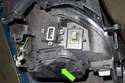 This photo shows Xenon bulb access door (green arrow).