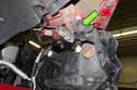 Working inside wheel well, remove T30 Torx fastener.