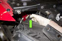 Pull out and remove headlight slightly, detach headlight washer hose and electrical connector (green arrow).