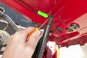 Use a small flathead screwdriver and lever the retaining clip to end of ball socket.