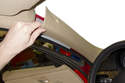 Pull A-pillar trim panel away from A-pillar while detaching it from the door seal.