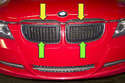 The radiator grills consist of two snap together grills (green arrows) and an upper trim piece (yellow arrows).