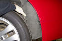 Peel back wheel well liner and wedge it behind tire to hold it out of your way.