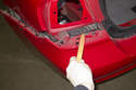 Once the corner of the bumper is release, use a plastic prying tool and release rear of bumper from mounting bracket.