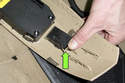 To replace the lumbar control switch, release tab (green arrow) then remove switch from trim panel.