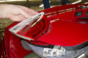 Then remove taillight lens from trunk lid by lifting inside of lens up and unclipping from outer edge of trunk lid.
