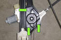 Remove three T30 Torx window motor fasteners (green arrows) then pull straight up to remove from window regulator.