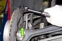Working at rear wheel bearing carrier, remove ABS sensor 5mm Allen fastener.
