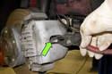 Pull brake pad wear sensor (green arrow) out of brake pad on the driver side brake pad.