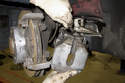 Remove brake caliper from mounting bracket and unscrew brake hose from caliper.