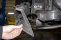 Then, remove brake duct from vehicle.