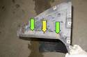To replace the front mud flap, remove two 8mm fasteners (green arrows) and one plastic rivet (yellow arrow).