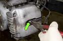 Pull brake pad wear sensor (green arrow) out of brake pad out of driver side brake pad.