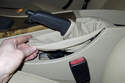 Then pull up parking brake lever boot to detach from center console.