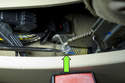 Using a long flathead screwdriver, engage parking brake service lock.