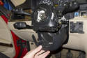 Once the lower trim panel is released, remove it from the steering column.