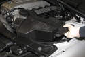Remove air filter housing from vehicle by lifting up and disconnecting duct from mass air flow sensor.