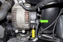Remove four E12 alternator fasteners.