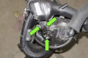 Working at crankcase breather valve, remove three Torx fasteners (green arrows).