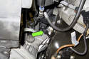 Working at engine oil dipstick tube, remove crankcase valve drain hose.