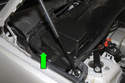 Then, detach rubber tab (green arrow) and remove E-box cover from vehicle.