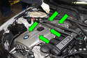 Remove five T40 Torx engine cover fasteners (green arrows) by rotating 90° counterclockwise, then remove cover from engine.