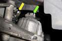 Working in engine bay, locate top of left side motor mount.
