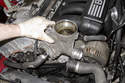 Pull oil filter housing away from engine and remove.
