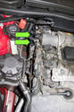 Locate oxygen sensor electrical connectors at right side of engine above exhaust manifold.