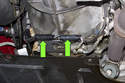 Locate oxygen sensor electrical connectors, they are mounted to a bracket at the bottom of transmission bell housing.