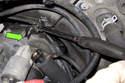 Next you will remove the upper starter fastener.