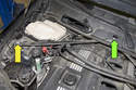 Working at wiper cowl, remove strut brace E20 fastener (green arrow).