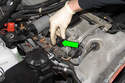 Unlock ignition coil electrical connector by pulling tab up 90